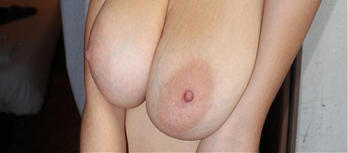 Blonde shows off her big areolas