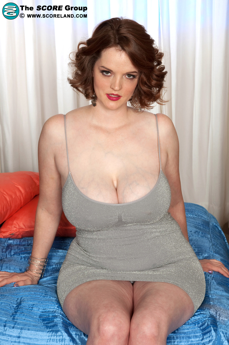Redhead with huge pale tits