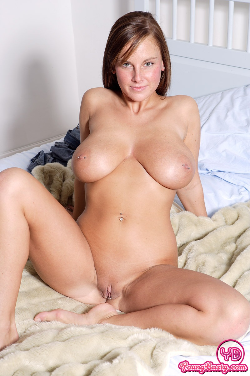 Mature on bed showing pussy